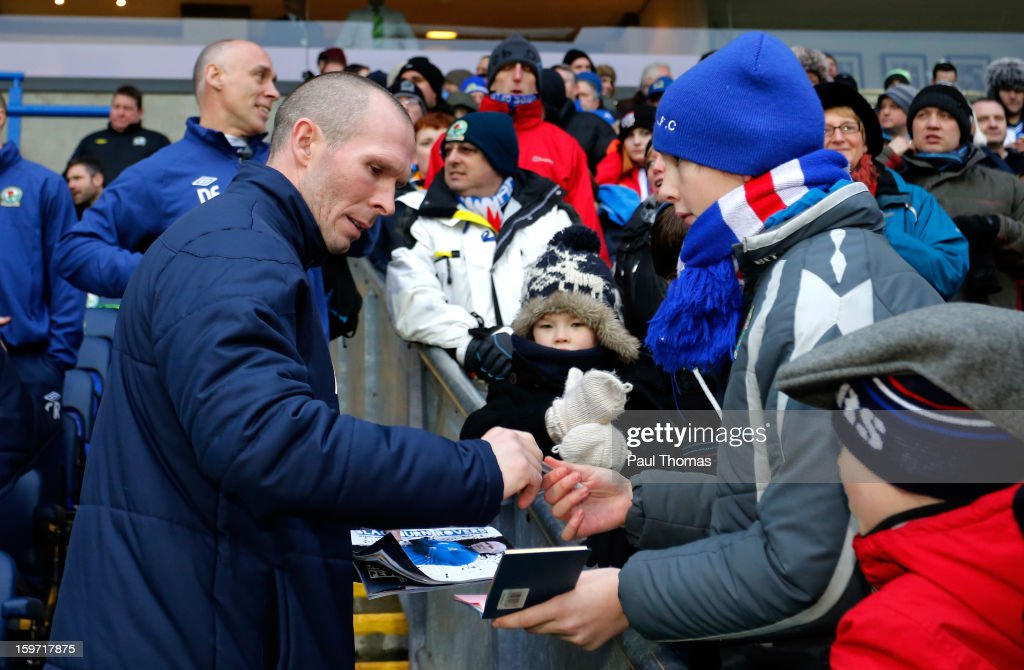Manager Michael Appleton (L) of Blackburn signs an autograph before the npower Championship match between Blackburn Rovers and Charlton Athletic at Ewood Park on January 19, 2013 in Blackburn, England.