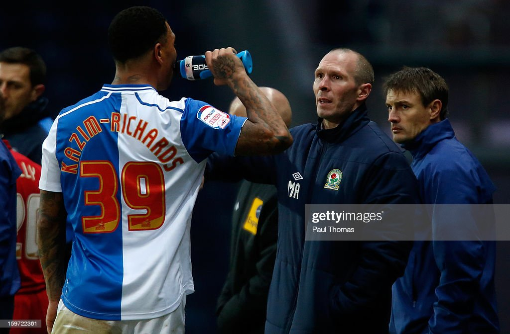 Manager Michael Appleton (C) of Blackburn speaks to his player Colin Kazim-Richards during the npower Championship match between Blackburn Rovers and Charlton Athletic at Ewood Park on January 19, 2013 in Blackburn, England.