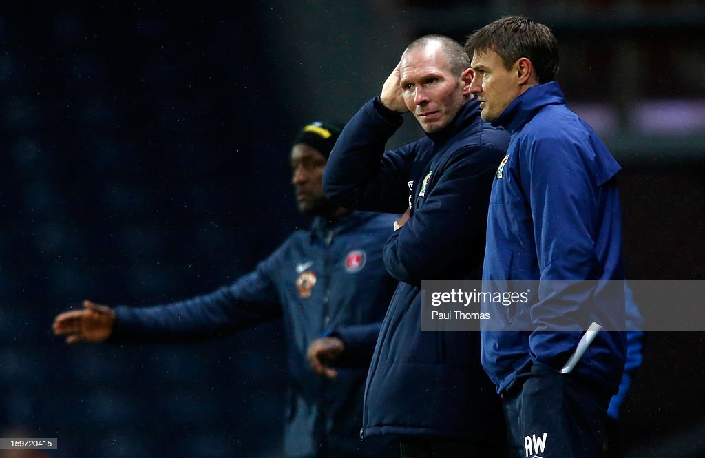 Manager Michael Appleton (C) of Blackburn speaks with his assistant manager Ashley Westwood during the npower Championship match between Blackburn Rovers and Charlton Athletic at Ewood Park on January 19, 2013 in Blackburn, England.