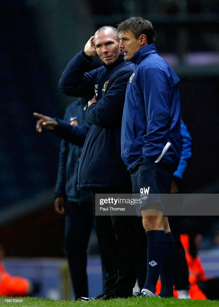 Manager Michael Appleton (C) of Blackburn speaks with his assistant Ashley Westwood during the npower Championship match between Blackburn Rovers and Charlton Athletic at Ewood Park on January 19, 2013 in Blackburn, England.