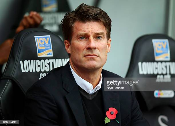 Manager Michael Laudrup of Swansea looks on before the Barclays Premier League match between Swansea City and West Ham United at Liberty Stadium on...