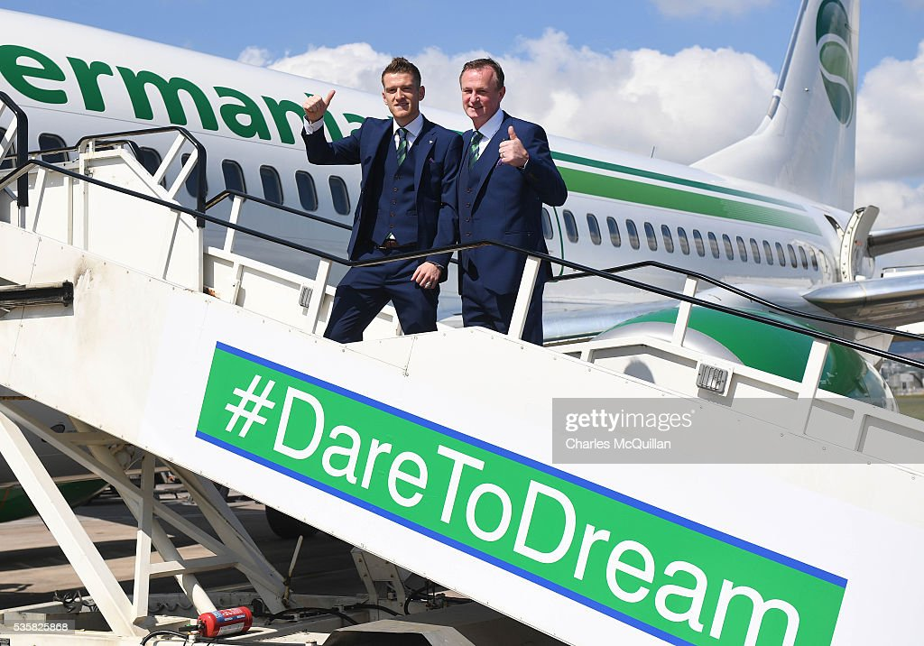 Manager Michael O'Neill (R) and captain Steve Davis (L) pose for an official photograph before their training camp departure at George Best City Airport on May 30, 2016 in Belfast, Northern Ireland. Northern Ireland have qualified for the Euro 2016 football championship finals in France, the first time the province has qualified for an international football tournament final since 1986.