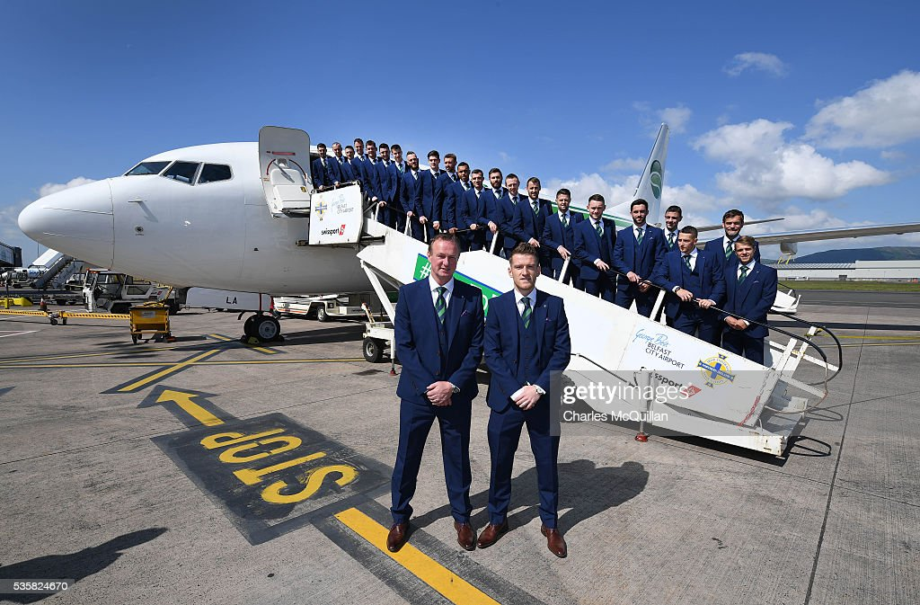 Manager Michael O'Neill (L) and captain Steve Davis (R) with the Northern Ireland team as they pose for an official photograph before their training camp departure at George Best Belfast City Airport on May 30, 2016 in Belfast, Northern Ireland. Northern Ireland have qualified for the Euro 2016 football championship finals in France, the first time the province has qualified for an international football tournament final since 1986.