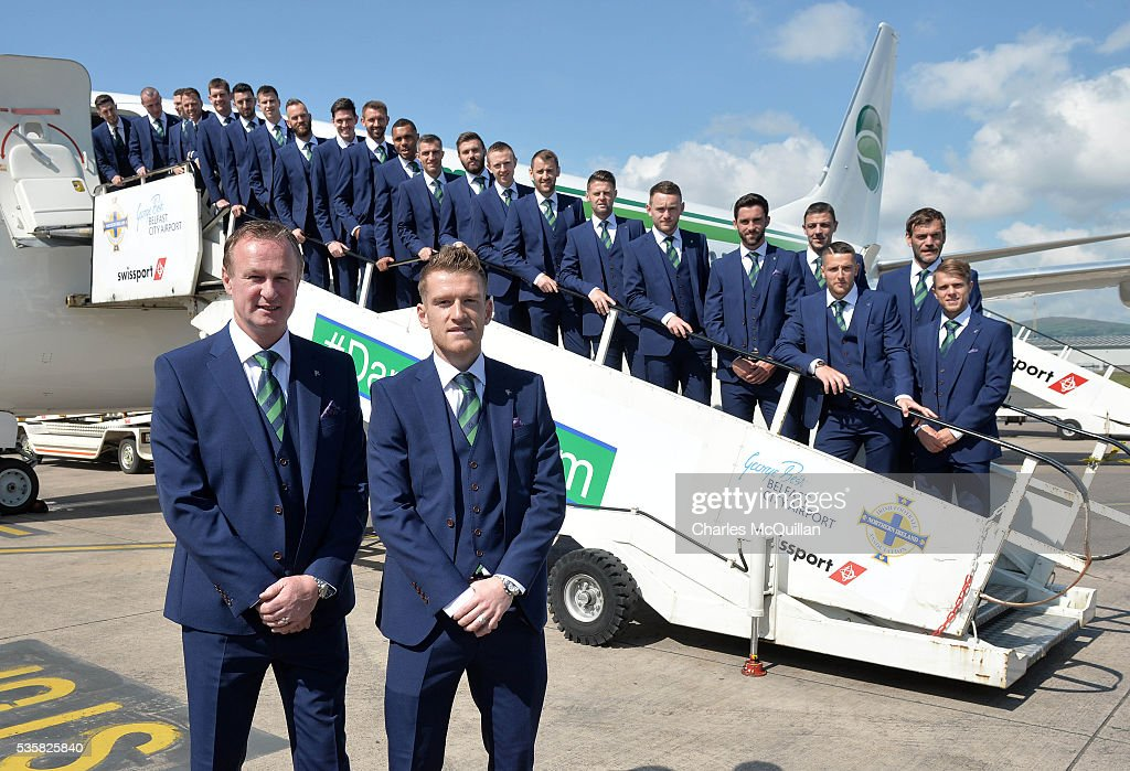Manager Michael O'Neill (L) and captain Steve Davis (R) with the Northern Ireland team as they pose for an official photograph before their training camp departure at George Best City Airport on May 30, 2016 in Belfast, Northern Ireland. Northern Ireland have qualified for the Euro 2016 football championship finals in France, the first time the province has qualified for an international football tournament final since 1986.