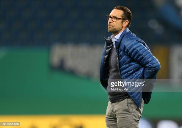 Manager Michael Preetz of Berlin looks on after the DFB Cup first round match between FC Hansa Rostock and Hertha BSC at Ostseestadion on August 14...
