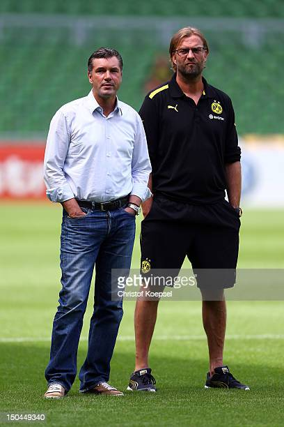 Manager Michael Zorc and head coach Juergen Klopp of Dortmund talk prior to the first round DFB Cup match between FC Oberneuland and Borussia...