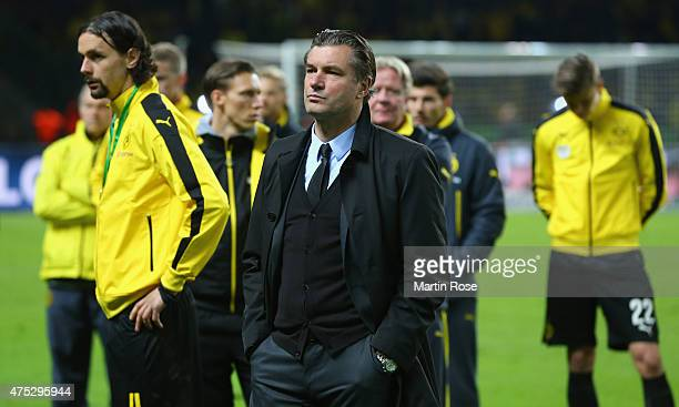 Manager Michael Zorc looks dejected after loosing the DFB Cup Final match between Borussia Dortmund and VfL Wolfsburg at Olympiastadion on May 30...