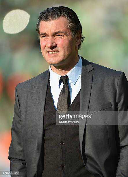 Manager Michael Zorc of Dortmund is seen prior to the DFB Cup Final match between Borussia Dortmund and VfL Wolfsburg at Olympiastadion on May 30...