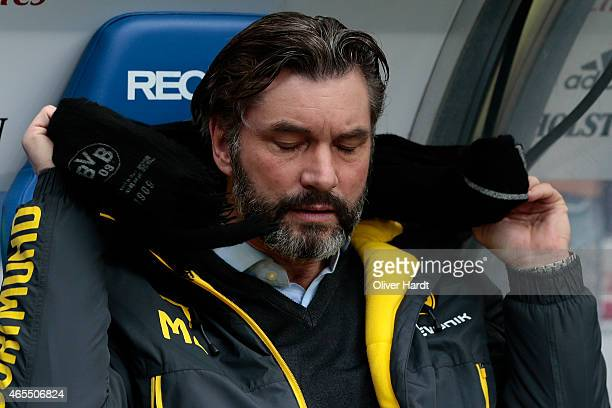 Manager Michael Zorc of Dortmund looks on prior to the First Bundesliga match between Hamburger SV and Borussia Dortmund at Imtech Arena on March 7...
