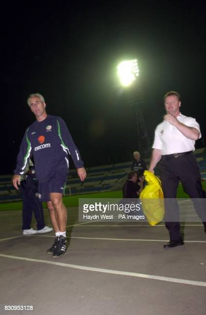 Manager Mick McCarthy leaves the field after training with the Irish squad in Moscow in preparation for Irelands' Euro 2004 International qualifier...
