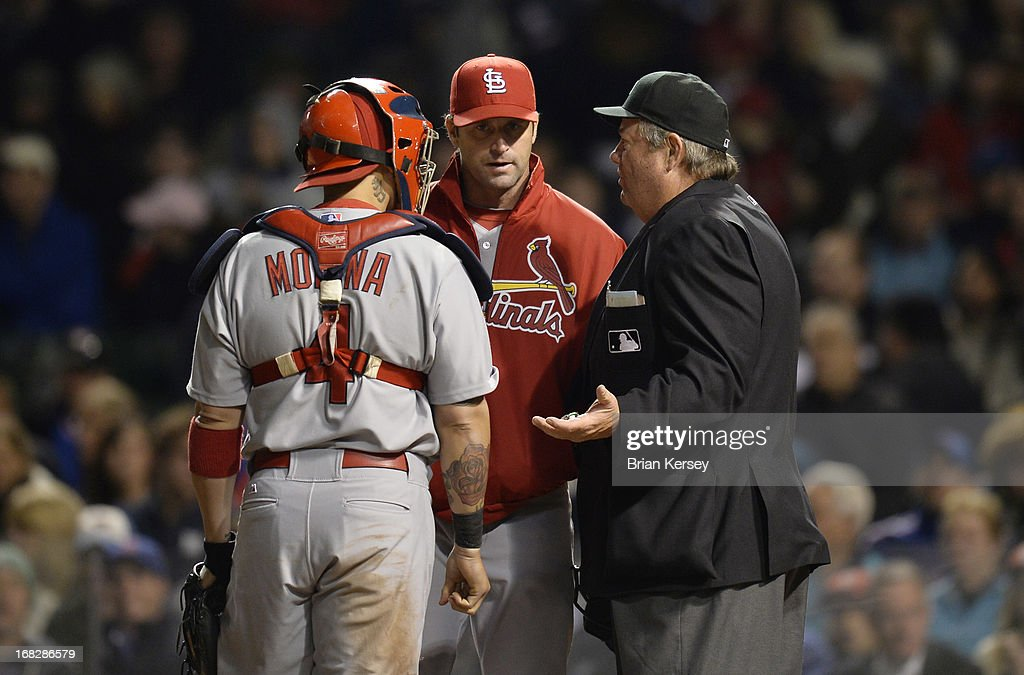 Manager Mike Matheny of the St Louis Cardinals and catcher Yadier Molina argue with home plate umpire Joe West after Welington Castillo of the...