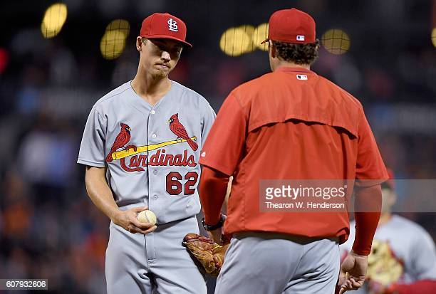 Manager Mike Matheny of the St Louis Cardinals comes out to take the ball from starting pitcher Luke Weaver taking Weaver out of the game against the...
