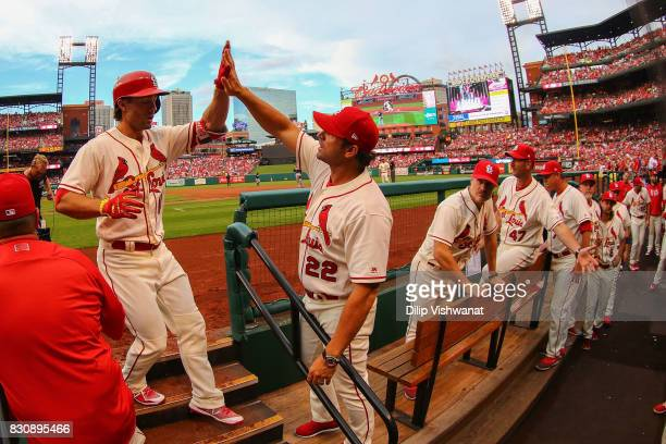Manager Mike Matheny of the St Louis Cardinals congratulates Randal Grichuk of the St Louis Cardinals after he hit a home run against the Atlanta...