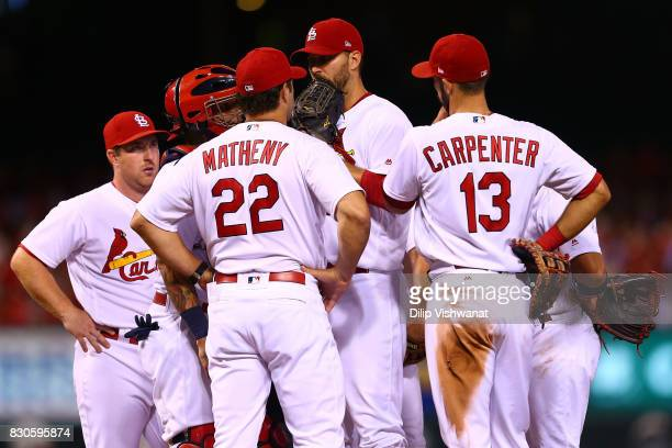 Manager Mike Matheny of the St Louis Cardinals meets with Adam Wainwright of the St Louis Cardinals in the third inning at Busch Stadium on August 11...