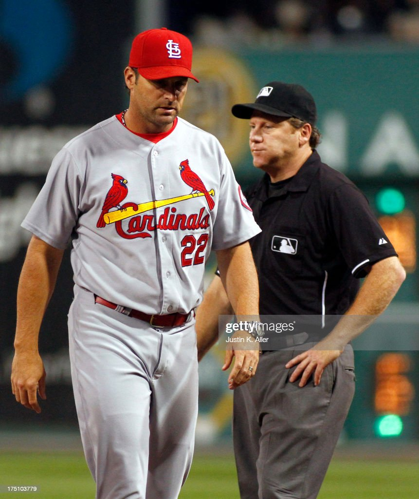Manager Mike Matheny #22 of the St. Louis Cardinals walks away from first base umpire Paul Schreiber after a arguing a safe call in the fifth inning against the Pittsburgh Pirates during the game on July 31, 2013 at PNC Park in Pittsburgh, Pennsylvania.
