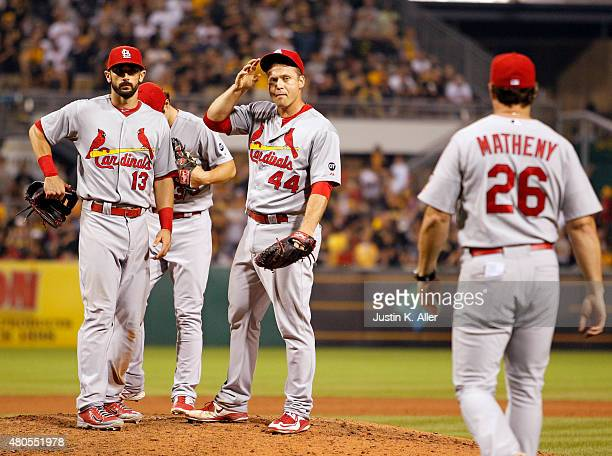 Manager Mike Matheny of the St Louis Cardinals walks to the mound to meet with pitcher Trevor Rosenthal of the St Louis Cardinals in the tenth inning...