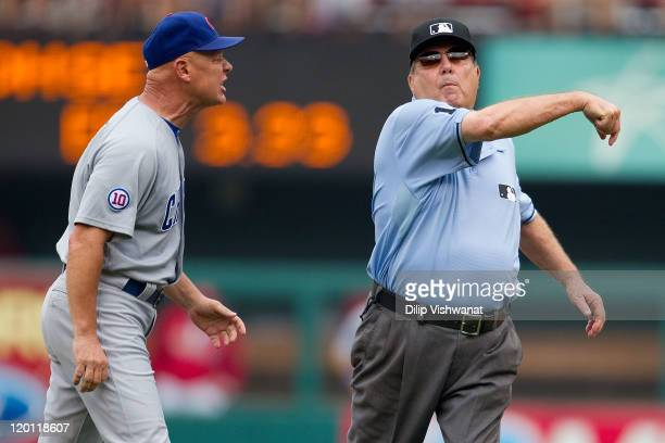 Manager Mike Quade of the Chicago Cubs is ejected from the game by second base umpire Derryl Cousins against the St Louis Cardinals at Busch Stadium...