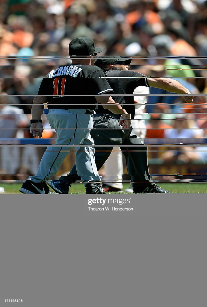 Manager <a gi-track='captionPersonalityLinkClicked' href=/galleries/search?phrase=Mike+Redmond&family=editorial&specificpeople=228450 ng-click='$event.stopPropagation()'>Mike Redmond</a> #11 of the Miami Marlins is tossed out of the game by first base umpire <a gi-track='captionPersonalityLinkClicked' href=/galleries/search?phrase=Mark+Wegner&family=editorial&specificpeople=226706 ng-click='$event.stopPropagation()'>Mark Wegner</a> #14 after Redmond argued a ground rule double call that allowed Barry Zito #75 of the San Francisco Giants to score from first base in the fifth inning at AT&T Park on June 22, 2013 in San Francisco, California.
