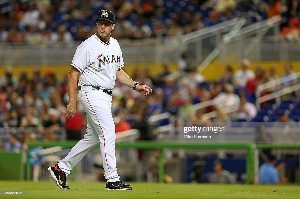 Manager <a gi-track='captionPersonalityLinkClicked' href=/galleries/search?phrase=Mike+Redmond&family=editorial&specificpeople=228450 ng-click='$event.stopPropagation()'>Mike Redmond</a> #11 of the Miami Marlins looks on during a game against the Texas Rangers at Marlins Park on August 19, 2014 in Miami, Florida.