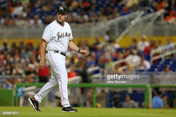 Manager Mike Redmond of the Miami Marlins looks on during a game against the Texas Rangers at Marlins Park on August 19 2014 in Miami Florida