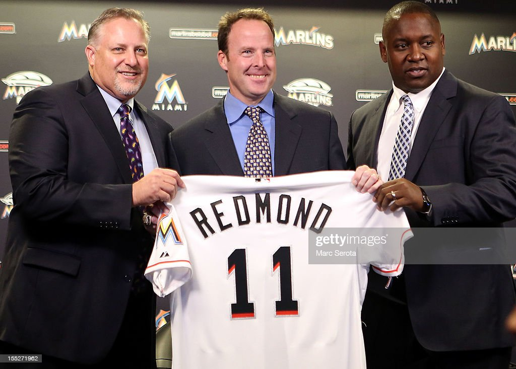 Manager <a gi-track='captionPersonalityLinkClicked' href=/galleries/search?phrase=Mike+Redmond&family=editorial&specificpeople=228450 ng-click='$event.stopPropagation()'>Mike Redmond</a> of the Miami Marlins (C) poses for photos with President, Baseball Operations Larry Beinfest (L) and General Manager Michael Hill after being named manager at Marlins Park on November 2, 2012 in Miami, Florida.