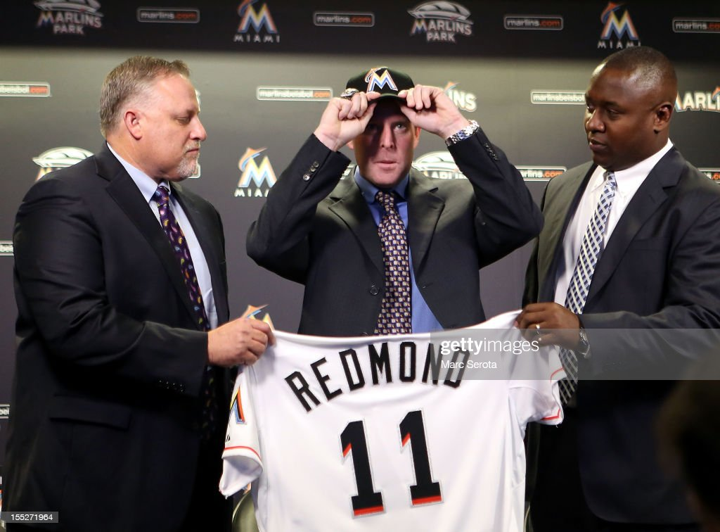Manager Mike Redmond of the Miami Marlins (C) poses for photos with President, Baseball Operations Larry Beinfest (L) and General Manager Michael Hill after being named manager at Marlins Park on November 2, 2012 in Miami, Florida.