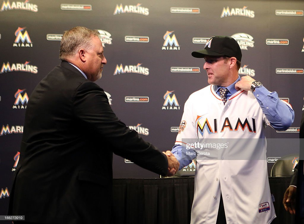 Manager Mike Redmond of the Miami Marlins (R) shakes hands with President of Baseball Operations Larry Beinfest after being named manager at Marlins Park on November 2, 2012 in Miami, Florida.