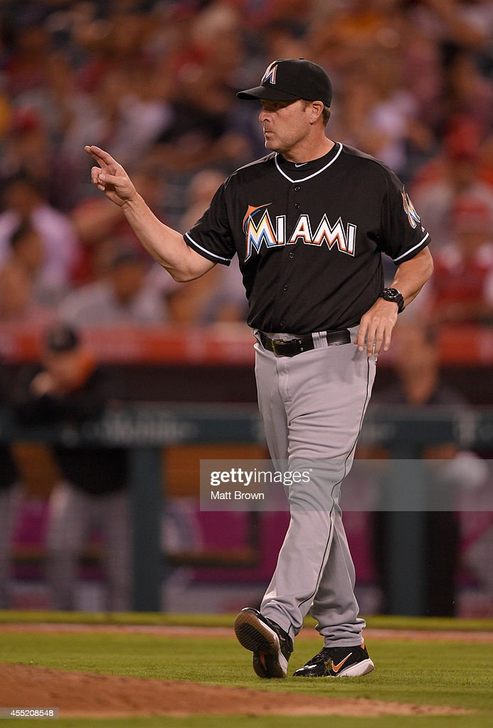 Manager <a gi-track='captionPersonalityLinkClicked' href=/galleries/search?phrase=Mike+Redmond&family=editorial&specificpeople=228450 ng-click='$event.stopPropagation()'>Mike Redmond</a> #11 of the Miami Marlins signals to the bullpen during the game against the Los Angeles Angels of Anaheim on August 25, 2014 at Angel Stadium of Anaheim in Anaheim, California.
