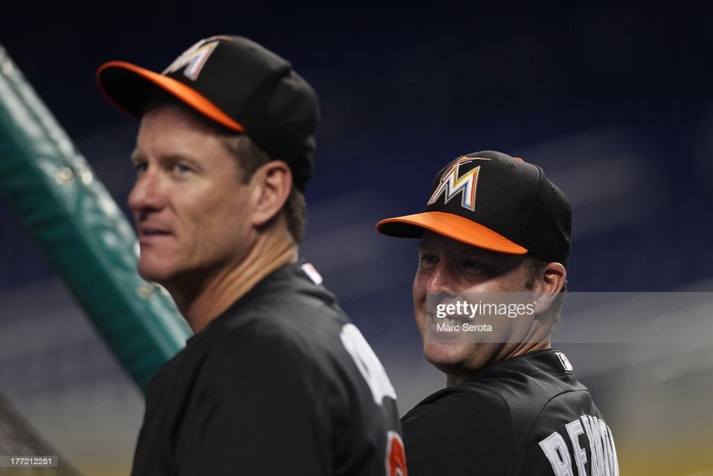 Manager <a gi-track='captionPersonalityLinkClicked' href=/galleries/search?phrase=Mike+Redmond&family=editorial&specificpeople=228450 ng-click='$event.stopPropagation()'>Mike Redmond</a> #11 of the Miami Marlins smiles during batting practice prior to his team playing against the San Francisco Giants at Marlins Park on August 16, 2013 in Miami, Florida. The Giants defeated the Marlins 14-10.