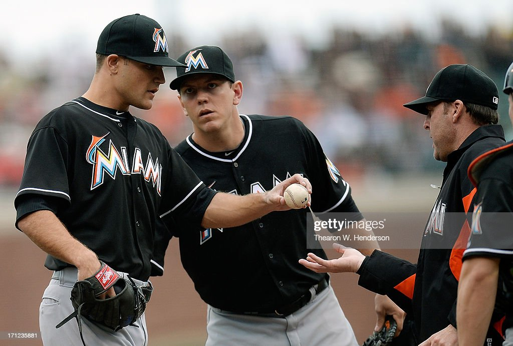 Manager Mike Redmond #11 of the Miami Marlins takes the ball from pitcher Dan Jennings #43 taking him out of the game in the seventh inning at AT&T Park on June 23, 2013 in San Francisco, California.