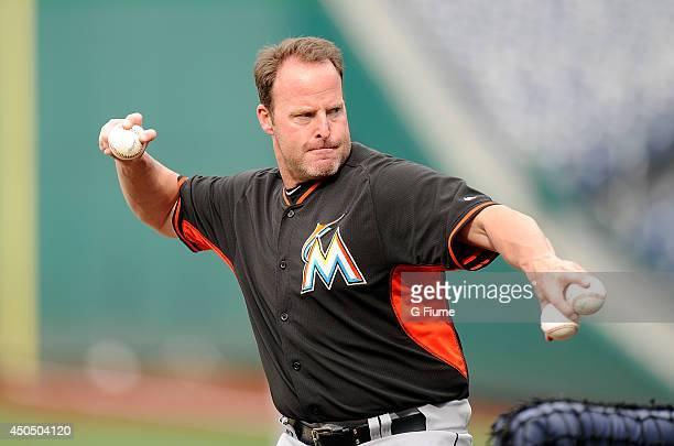 Manager Mike Redmond of the Miami Marlins throws batting practice before the game against the Washington Nationals at Nationals Park on May 28 2014...