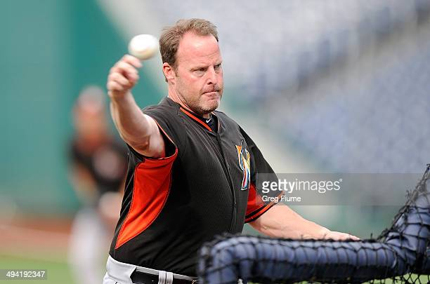 Manager Mike Redmond of the Miami Marlins throws during batting practice before the game against the Washington Nationals at Nationals Park on May 28...