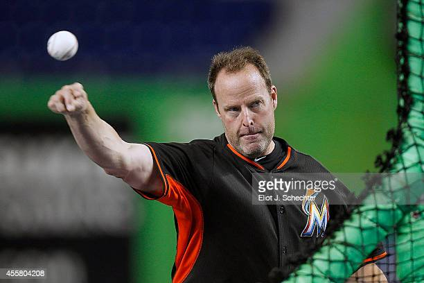 Manager Mike Redmond of the Miami Marlins throws endless pitches during batting practice prior to the start of the game against the Washington...