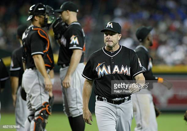 Manager Mike Redmond of the Miami Marlins walks from the mound after a pitching change during the eighth inning of a MLB game at against the Arizona...
