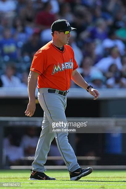 Manager Mike Redmond of the Miami Marlins walks on the field against the Colorado Rockies at Coors Field on August 24 2014 in Denver Colorado