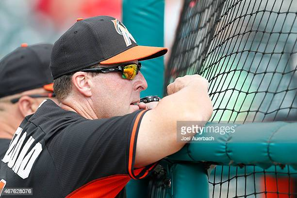 Manager Mike Redmond of the Miami Marlins watches batting practice prior to the spring training game against the St Louis Cardinals during a spring...