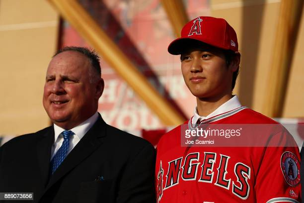 Manager Mike Scioscia and Shohei Ohtani pose for a photo during the Shohei Ohtani introduction to the Los Angeles Angels of Anaheim at Angel Stadium...