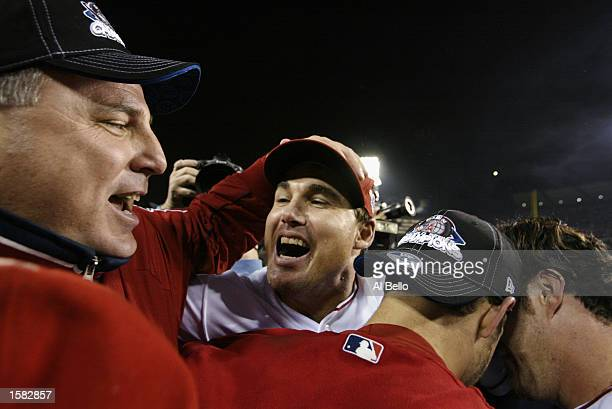Manager Mike Scioscia of the Anaheim Angels celebrates with player Tim Salmon after winning game seven of the World Series against the San Francisco...