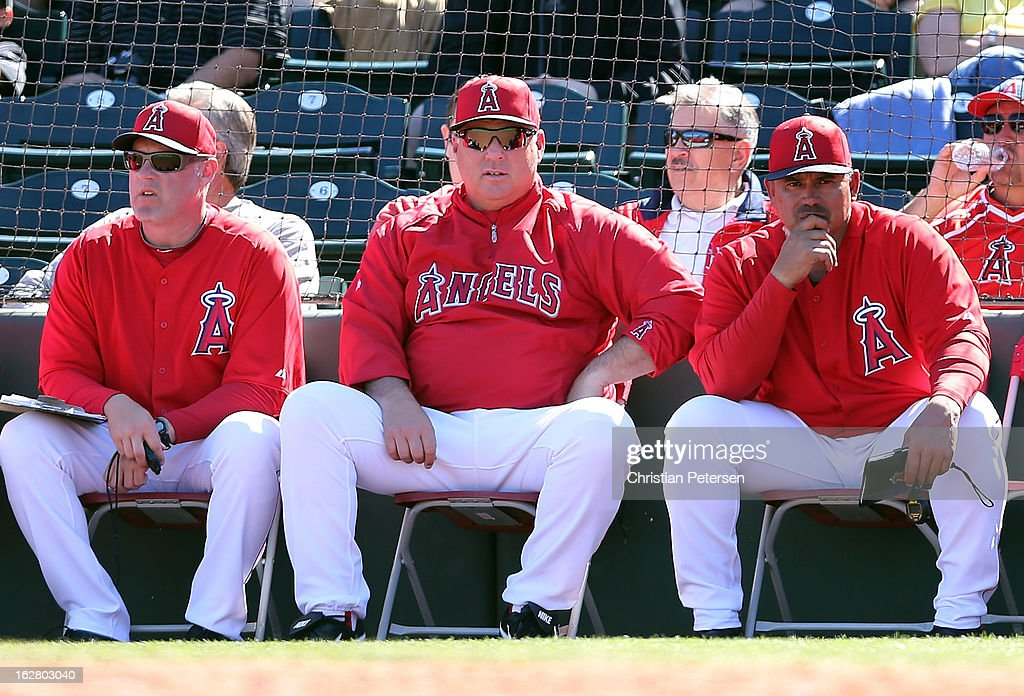 Manager <a gi-track='captionPersonalityLinkClicked' href=/galleries/search?phrase=Mike+Scioscia&family=editorial&specificpeople=206319 ng-click='$event.stopPropagation()'>Mike Scioscia</a> (C) of the Los Angeles Angels looks on during the spring training game against the San Francisco Giants at Tempe Diablo Stadium on February 27, 2013 in Tempe, Arizona.