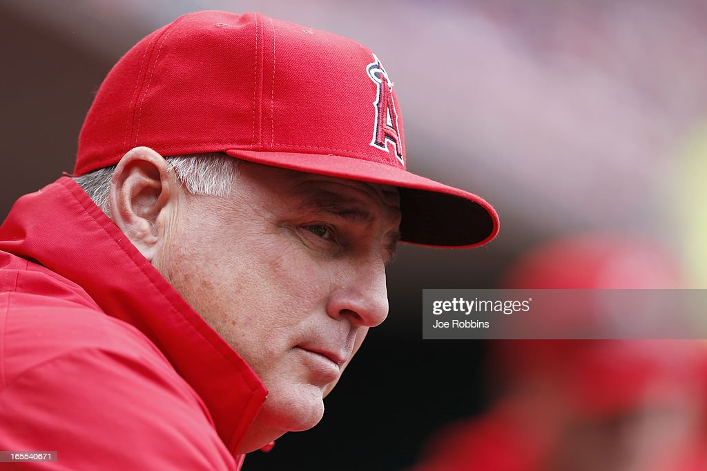 Manager <a gi-track='captionPersonalityLinkClicked' href=/galleries/search?phrase=Mike+Scioscia&family=editorial&specificpeople=206319 ng-click='$event.stopPropagation()'>Mike Scioscia</a> of the Los Angeles Angels of Anaheim looks on against the Cincinnati Reds during the game at Great American Ball Park on April 4, 2013 in Cincinnati, Ohio. The Reds won 5-4.