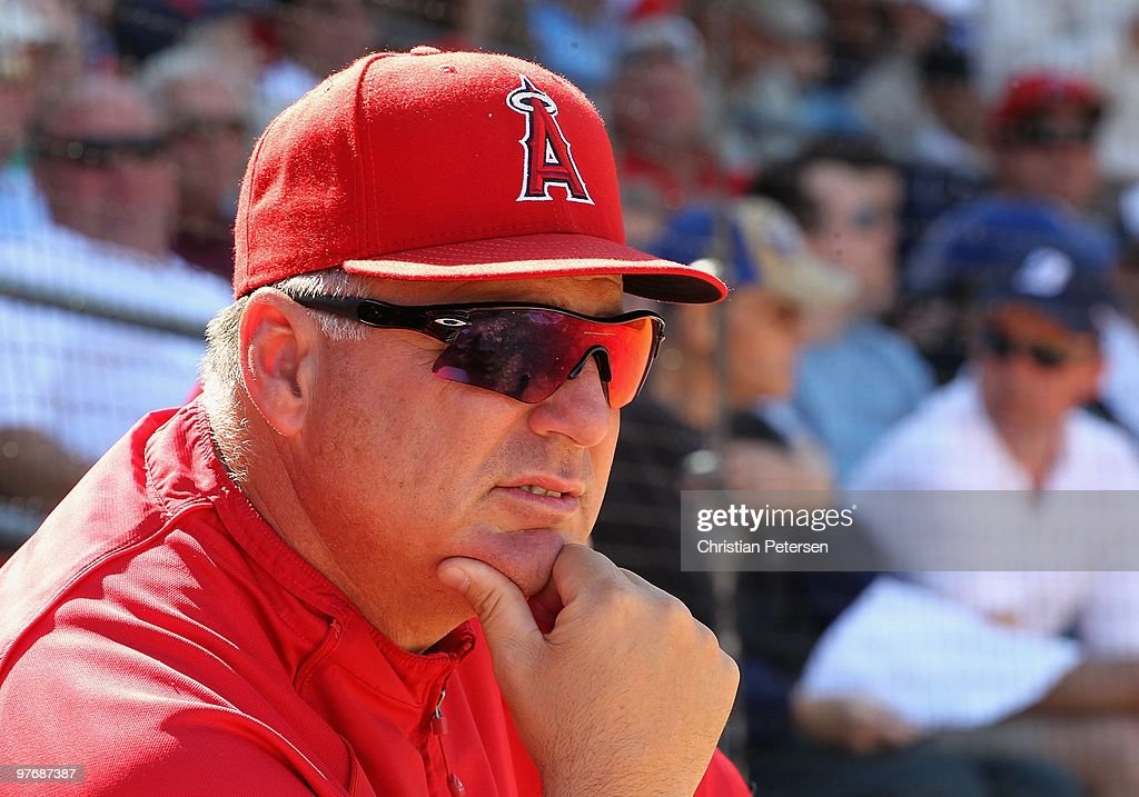 Manager <a gi-track='captionPersonalityLinkClicked' href=/galleries/search?phrase=Mike+Scioscia&family=editorial&specificpeople=206319 ng-click='$event.stopPropagation()'>Mike Scioscia</a> of the Los Angeles Angels of Anaheim looks on during the MLB spring training game against the Kansas City Royals at Surprise Stadium on March 13, 2010 in Surprise, Arizona. The Royals defeated the Angels 12-3.