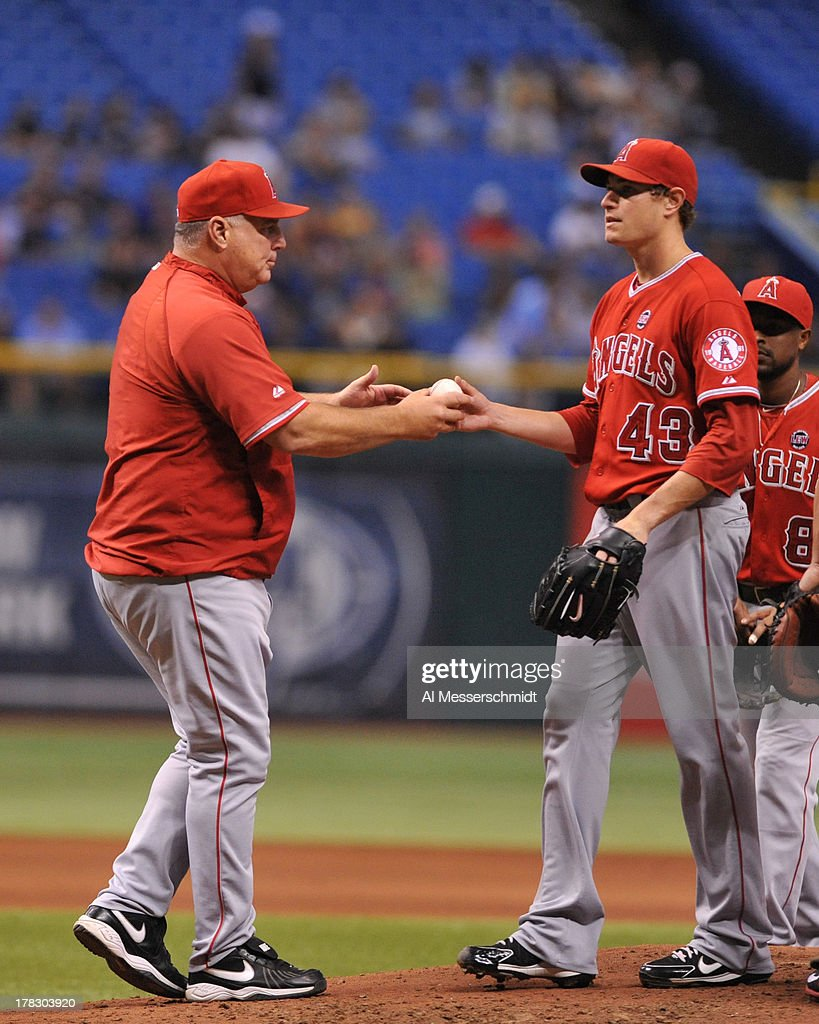 Manager <a gi-track='captionPersonalityLinkClicked' href=/galleries/search?phrase=Mike+Scioscia&family=editorial&specificpeople=206319 ng-click='$event.stopPropagation()'>Mike Scioscia</a> of the Los Angeles Angels of Anaheim of Anaheim removes pitcher <a gi-track='captionPersonalityLinkClicked' href=/galleries/search?phrase=Garrett+Richards&family=editorial&specificpeople=5772916 ng-click='$event.stopPropagation()'>Garrett Richards</a> #43 against the Tampa Bay Rays August 28, 2013 at Tropicana Field in St. Petersburg, Florida. The Rays won 4 - 1.