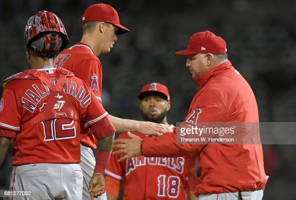 Manager Mike Scioscia of the Los Angeles Angels of Anaheim takes the ball from starting pitcher Alex Meyer taking him out of the game against the...