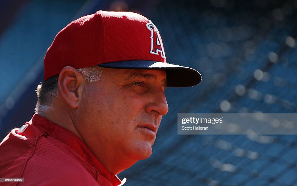 Manager Mike Scioscia of the Los Angeles Angels of Anaheim waits near the batting cage before the start of the game against the Houston Astros at Minute Maid Park on May 8, 2013 in Houston, Texas.