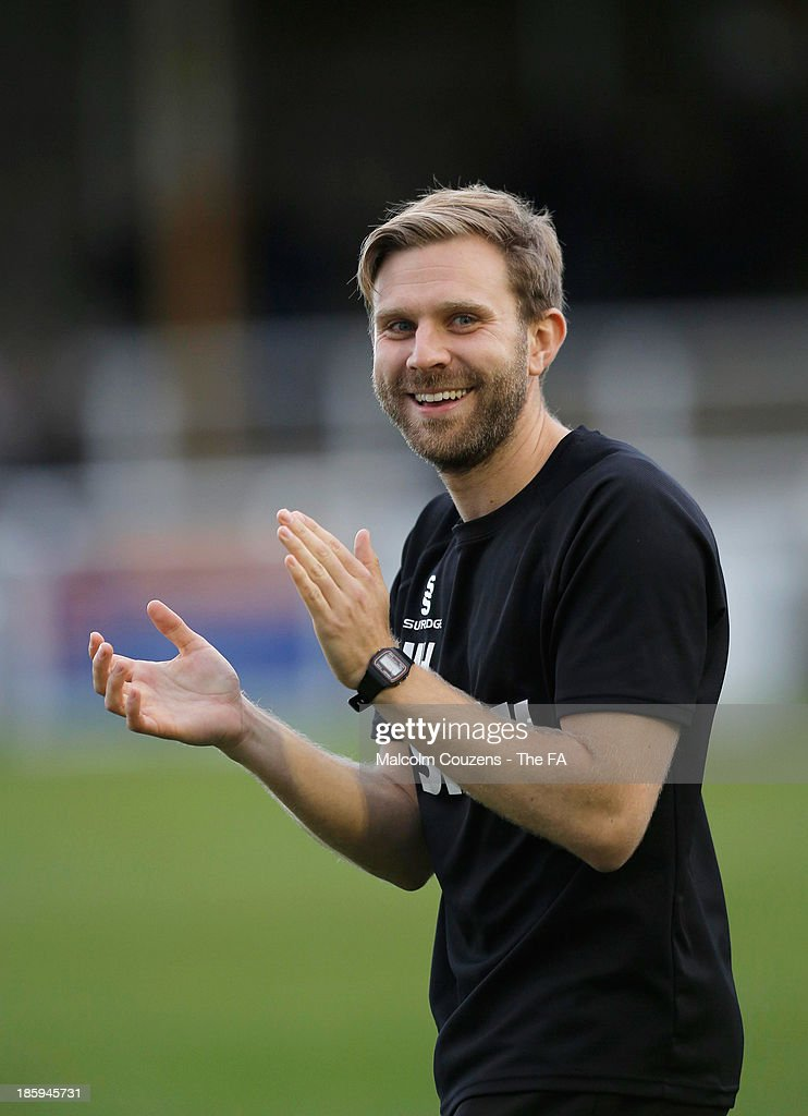 Manager Mikey Harris of Salisbury applauds following the FA Cup fourth qualifying round match between Bath City and Salisbury at Twerton Park , Bath on October 26th 2013,