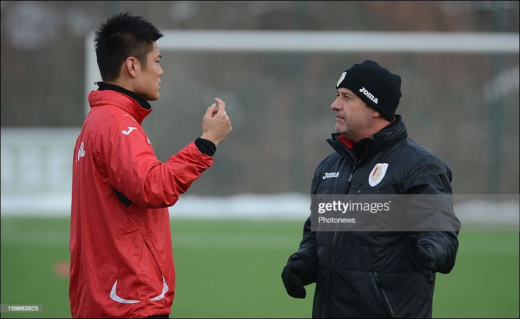 Manager Mircea Rednic talks to new signing Yuji Ono of Standard Liege attend a training session on January 22, 2013 in Liege, Belgium.