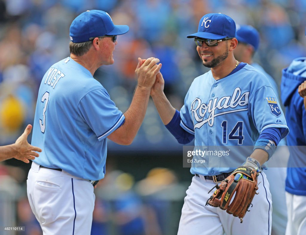 Manager Ned Yost #3 of the Kansas City Royals and Omar Infante #14 celebrate a 5-2 win over the Detroit Tigers on July 13, 2014 at Kauffman Stadium in Kansas City, Missouri.