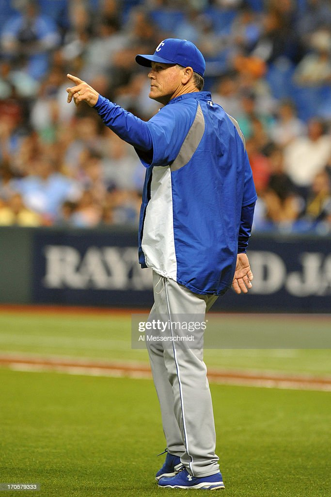 Manager Ned Yost of the Kansas City Royals calls for a relief pitcher against the Tampa Bay Rays June 14, 2013 at Tropicana Field in St. Petersburg, Florida.