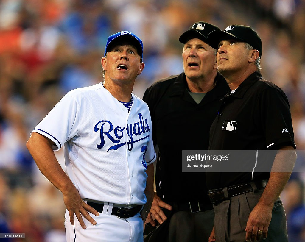 Manager <a gi-track='captionPersonalityLinkClicked' href=/galleries/search?phrase=Ned+Yost&family=editorial&specificpeople=228571 ng-click='$event.stopPropagation()'>Ned Yost</a> #3 of the Kansas City Royals looks up at a bank of lights that are out alongside home plate umpire Bob Davidson #61 and first base umpire Jim Reynolds #77 during the game against the Atlanta Braves at Kauffman Stadium on June 25, 2013 in Kansas City, Missouri.