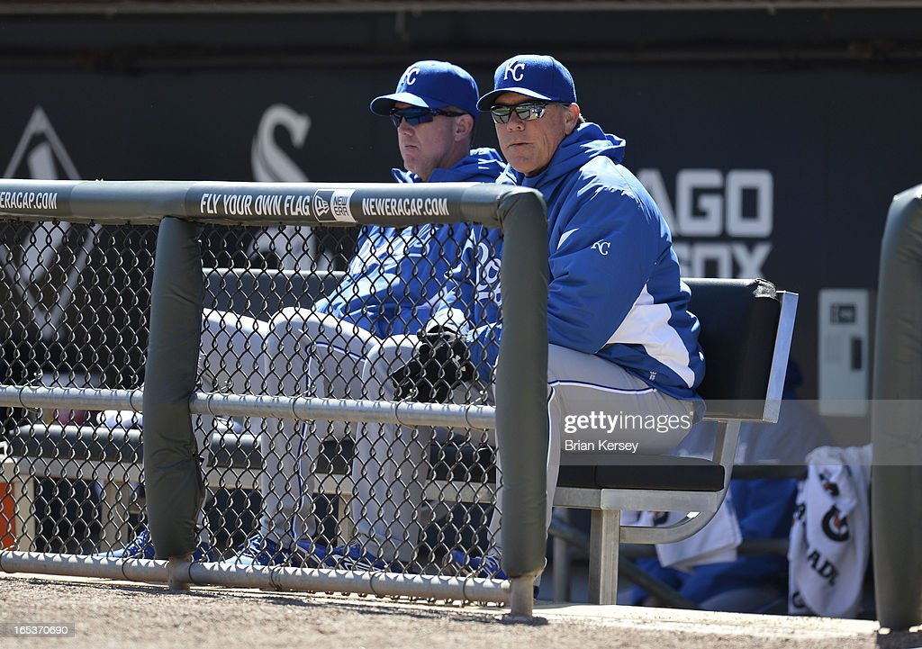 Manager Ned Yost #3 of the Kansas City Royals sits in the dugout as his team plays the Chicago White Sox on April 3, 2012 at U.S. Cellular Field in Chicago, Illinois. The White Sox defeated the Royals 5-2.